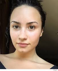 the america s next top model creator and host isn t the only star embracing her raw and real face these days demi lovato has been posting makeup less