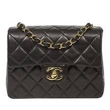 Chanel Mini Flap Bag 18cm in black quilted lambskin at 1stdibs & Chanel Mini Flap Bag 18cm in black quilted lambskin 1 Adamdwight.com