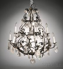 spanish baroque style twelve light wrought iron and rock crystal chandelier