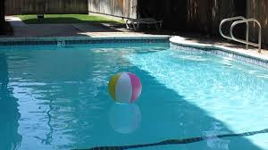 pool water with beach ball. Beach Ball In E\u0027s Swimming Pool Water With