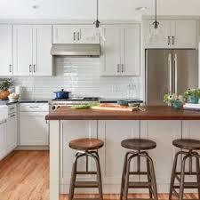 Large Farmhouse Enclosed Kitchen Designs   Inspiration For A Large Farmhouse  L Shaped Medium Tone