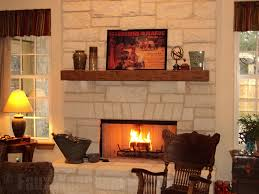 tuscany mantel installed over a fireplace