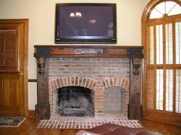 archaic farm living room decoration using aged brick fireplace surround including solid cherry wood shelf over fireplace and fireplace mantel lamp