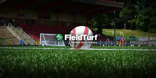 artificial football turf. Football Player Artifical Turf FieldTurf Artificial