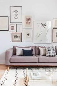 home office repin image sofa wall. modern art wall over an amethyst upholstered sofa featuring framed black and white sepia prints home office repin image