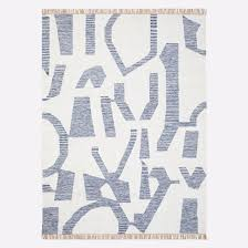 this abstract patterned blue and white rug would add a handsome dash of colour and whimsy to any terrace or patio it s also hand woven reversible