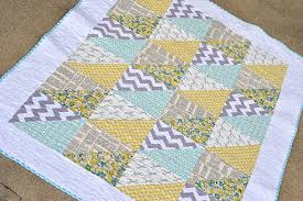 10 Easy Baby Quilt Patterns That Stitch Up Quick & triangles quick baby quilt design Adamdwight.com