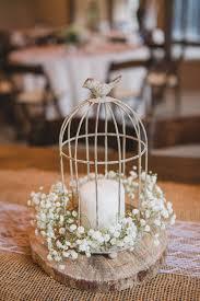 Birdcage, candle, babys breath rustic centerpiece on a wood round. Magnolia  Plantation wedding