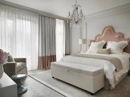 pink and gray bedroom with pink velvet headboard and pink banded curtains