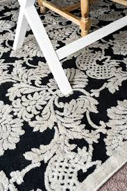 a review of the nourison graphic illusions black damask area rug from rug studio the