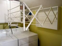 15 Wall Mounted Clothes Drying Designs For Saving Space : Creative DIY Wall Mounted  Clothes Drying Rack with Solid White Wood Materials Types hanging on the ...