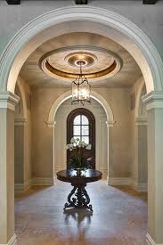foyer light fixtures entry terranean with archways carved ceiling treatment foyer front door