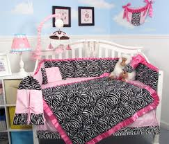 adorable baby bedding set design featuring white baby crib decor with pink zebra