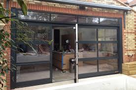 glass sectional door with pedestrian door inset