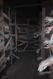 Front porch idea or great idea for haunted house. the real trick is to have  a false wall that someone stands behind, reaching an arm through.