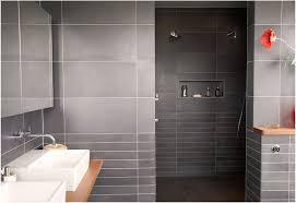bathroom modern bathroom tiles curved wall mirror dark gray tile accent floor mount tub faucet