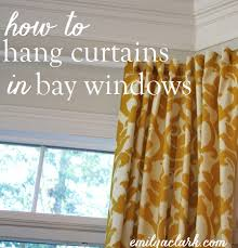 how to hang curtains in bay windows