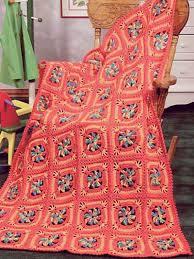 Child's Pinwheel Squares Crochet Afghan Pattern The bright and ... & Child's Pinwheel Squares Crochet Afghan Pattern The bright and cheery  colors of this crochet afghan pattern Adamdwight.com