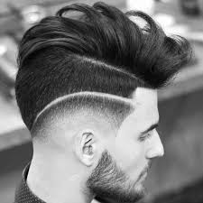 cute guy haircut drop fade and surgical part with long bed over hair
