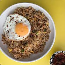 Neutral vegetable oil 150g chicken breast, thinly sliced 2 garlic cloves, minced 2 tbsp sambal oelek ½ red onion, diced How To Cook The Perfect Nasi Goreng Recipe Food The Guardian