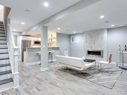 basement gas fireplace contemporary basement with carpet high ceiling stone porcelain tile hardwood floors columns basement