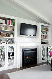 taller mirror front cabinets and built ins flanking tv fireplace
