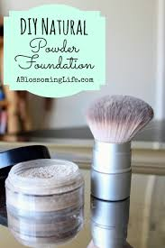 diy foundation in plastic container on a metal pan with a makeup brush next to it