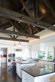 lighting for beams. ceiling mount track lighting contemporary kitchen by hyde evans design for beams