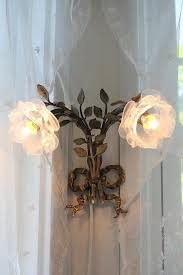 shabby chic lighting. two sconces on each side of newly shabby chicdecorated room chic lighting
