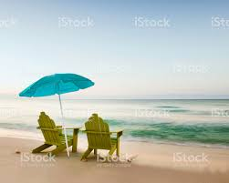Adirondack chairs on beach Wallpaper Adirondack Chairs On Beach With Unbrella Stock Image Istock Adirondack Chairs On Beach With Unbrella Stock Photo More Pictures