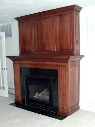 custom crafted cherry finished fireplace mantel and entertainment utnit