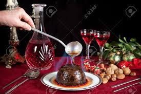 Hand Serving Burning Brandy Over A Christmas Or Plum Pudding Stock ...