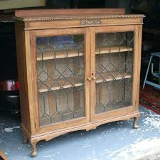 glass front bookcase light solid oak leaded glass fronted display cabinet bookcase suspect antique oak glass glass front bookcase
