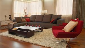 living room red white and black brown erfly low gas fireplace orange bird grey bottles table