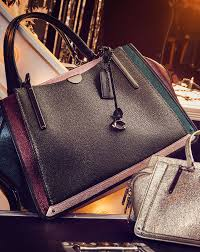 Parker in Signature Canvas With Rivets and Snakeskin Detail · Shop Shoulder  Bags