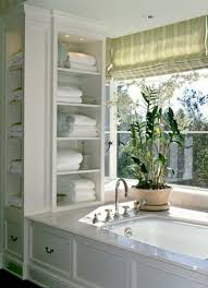 built in open shelves next ot the bathtub are a very comfy idea