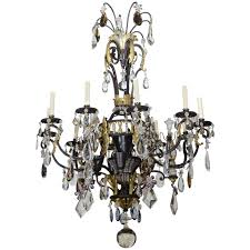 large french iron gilt iron crystal and rock crystal chandelier