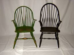 this picture gives you a sense of the overall lines of the two chairs in my view the chair on the left has nicer lines and better composition