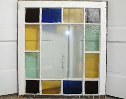 1880 s queen anne textured glass includes deep rose light green royal blue yellow and clear no glass pane in the center 28 w x 31 h 200