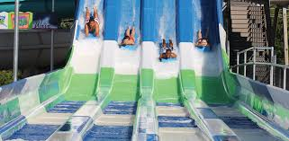 four s racing down water slides