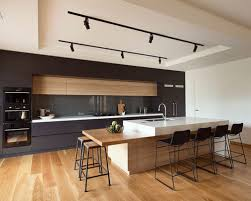 Mid-sized modern kitchen appliance - Mid-sized modern galley medium tone  wood floor