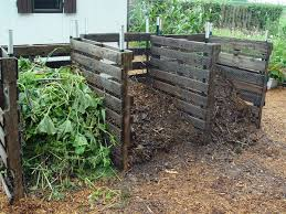 garden compost. this composting area uses recycled skids for bins and features three of them in different stages garden compost d
