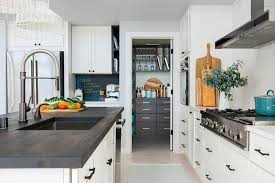 dark stained wood countertop on white island