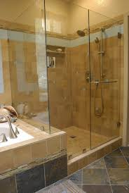 bathroom natural granite wall and flooring with glass wall on