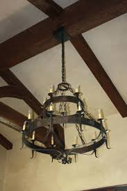 chandeliers hand forged iron chandelier made by haciendalightscom franklin iron works amber scroll 31 12