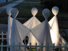 A bunch of old white sheets could easily be turned into nice Halloween  ghost costumes or