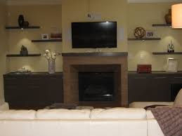 Over The Fireplace Tv Cabinet Terrific Black Wooden Floating Shelves For Crafts Holder And Wall