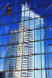 Reflection Of A Skyscraper In Glass Office Windows Stock Photo