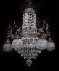 6 headed 1930s belgian stag head chandelier with 6 globe lights and 5 central lights