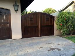 wood driveway gates tungsten royce custom cedar gate with decorative iron interiors by design